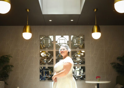 Bride standing in the Breakfast area of the Fifth Avenue Syndicate