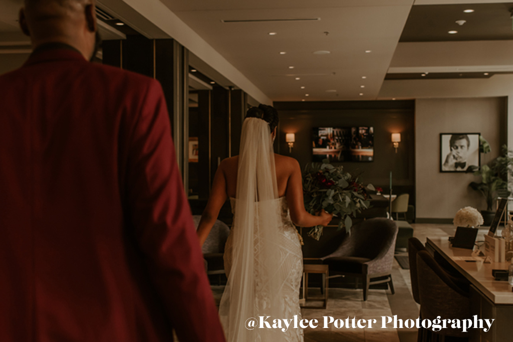 Bride walking to the aisle at the Axis Hotel